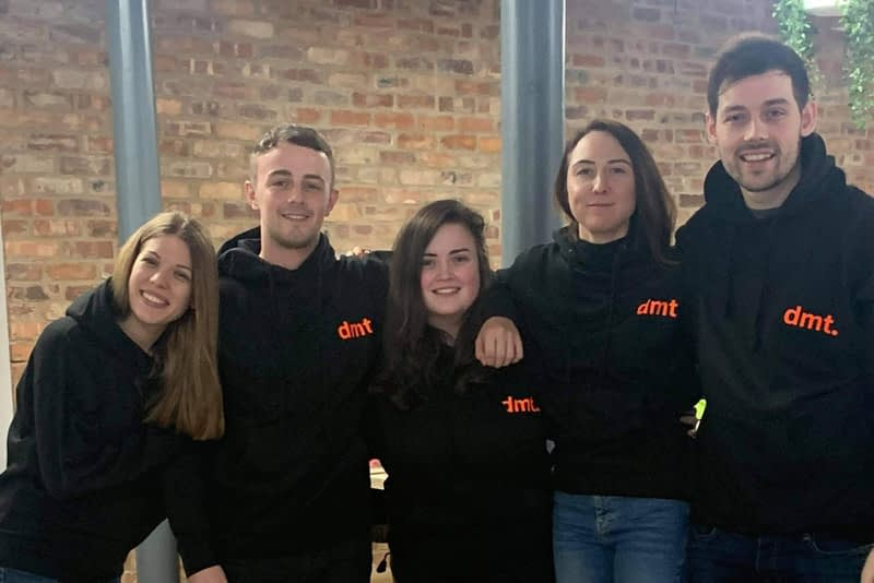 digital media team in branded hoodies